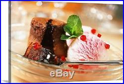Premium Thick-Wrap Canvas entitled Chocolate pudding with strawberry ice cream